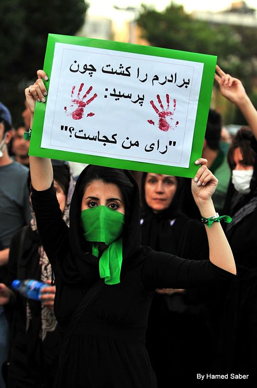 Woman holding a sign during a protest in Iran 2009