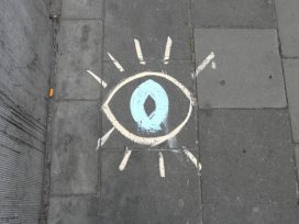 street graffiti showing an eye