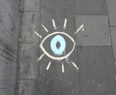 street graffiti showing an eye