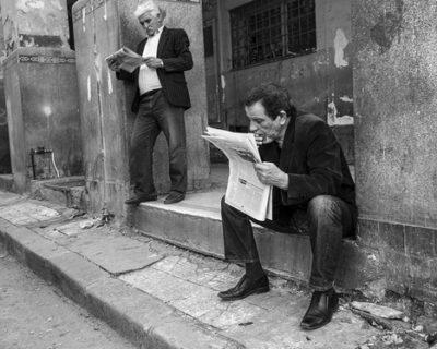 Algerian men reading newspapers