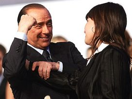 Berlusconi talking to a woman