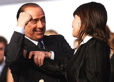 Berlusconi talking to a woman