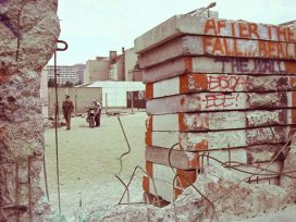 Peekaboo through holes of the Berlin wall